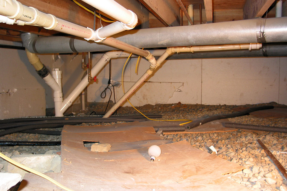 Messy Crawl Space Prior to Adding Vapor Barrier